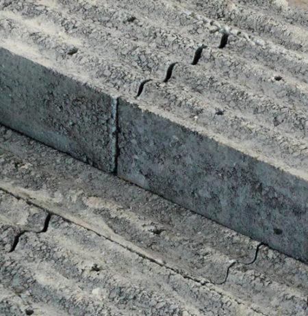 Concrete based lead-free bricks, for radiation shielding
