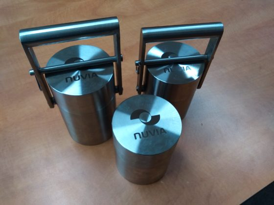Three lead containers for radioactive materials
